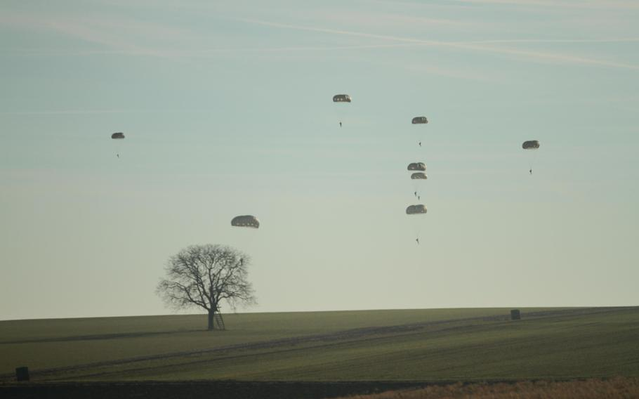 U.S. and European military personnel parachute onto a farmer's field Monday, Dec. 16, 2013, outside the Germany town of Alzey.