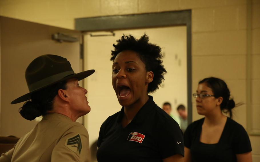 Senior drill instructor Sgt. Chasitie Chambers corrects Rct. Phyenisite McAllister, Platoon 4008, Company N, 4th Recruit Training Battalion, for her attitude Dec. 16, 2013, on Parris Island, S.C.  Recruits must learn quickly that the rules of recruit training are strictly enforced, and disrespecting supervisors is not tolerated.