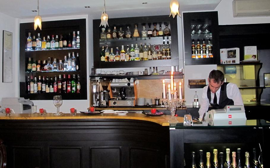 The beautiful bar at tira tardi, an upscale restaurant in Vicenza, Italy. Things get busier later in the evening.