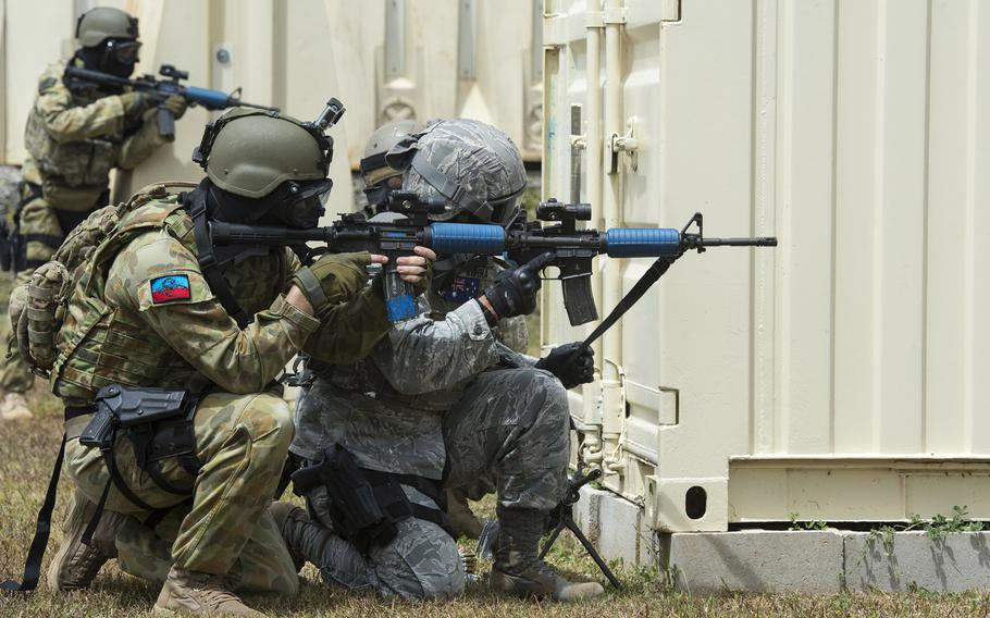 U.S. Air Force airmen and Royal Australian air force airfield defense guards work to eliminate an opposing force as part of a combat scenario during exercise Cope North 15, on Feb. 23, 2015, at the Commando Warrior Pacific Regional Training Center on Andersen Air Force Base, Guam.