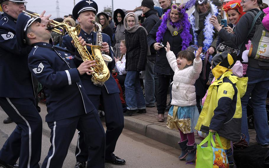 Members of the U.S. Air Forces in Europe Band interact with the crowd during the Fasching parade on Feb. 17, 2015, in Ramstein-Miesenbach, Germany. The USAFE Band and approximately 1,400 other participants marched in the parade for more than two hours.