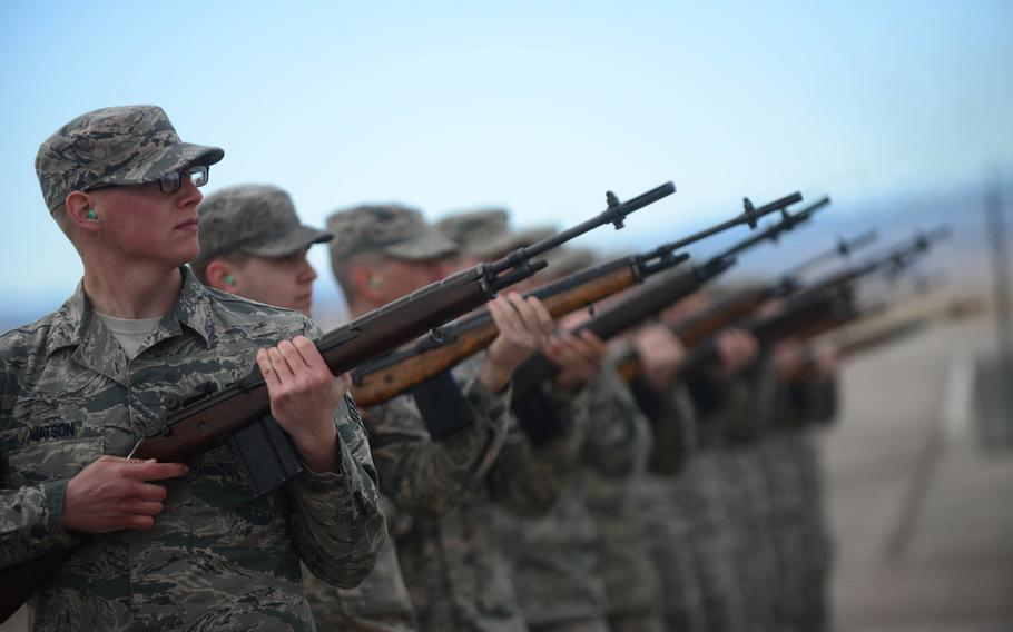 Honor guardsmen practice live-firing party movements on Feb. 9, 2015, at Ellsworth Air Force Base, S.D.