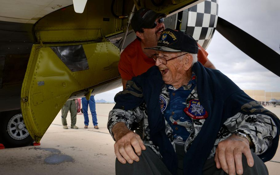 Retired Air National Guard Chief Warrant Officer 2 Robert Hertel, laughs while under the wing of a P-47 Thunderbolt during the Heritage Flight Training and Certification Course on Feb. 28, 2015, at Davis-Monthan Air Force Base, Ariz. Hertel, a 92-year-old World War II veteran, was given the opportunity to visit the aircraft he used to fly.