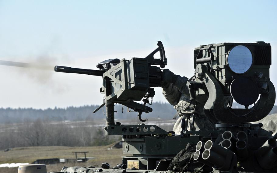 Dragoons assigned to the 2nd Cavalry Regiment participate in their unit's live-fire exercise at the Grafenwoehr Training Area, located near Rose Barracks, Germany, Feb. 27, 2015.
