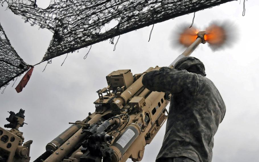 Paratroopers from the 82nd Airborne Division fire their M777 towed howitzer at high angle as part of Table VI Section Qualifications on Fort Bragg, N.C.