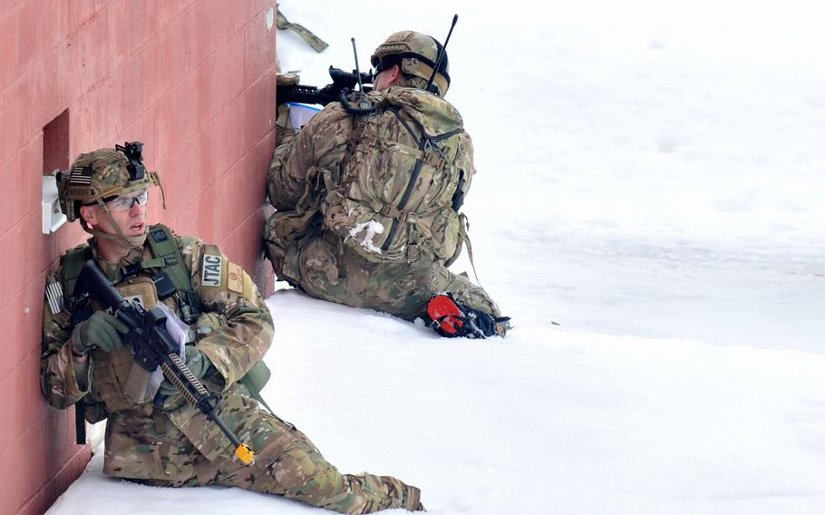 Capt. Jeffrey Hansen, with tactical air control, establishes a perimeter and firing team during an exercise at Fort Drum, N.Y., on March 14, 2015.