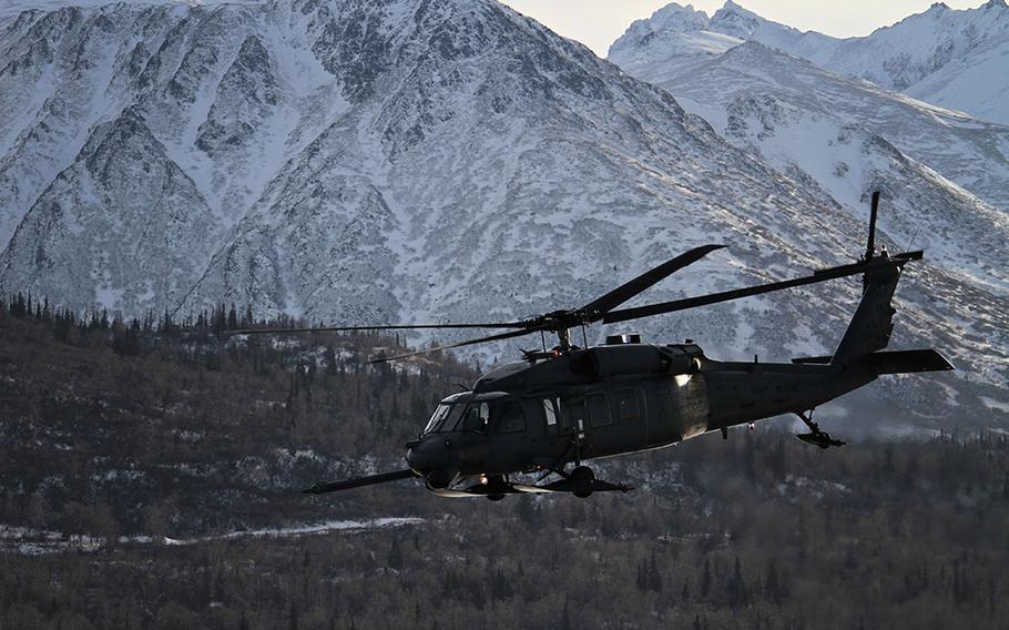 An Alaska Air National Guard HH-60 Pave Hawk from the 210th Rescue Squadron conducts a 2013 training flight near Joint Base Elmendorf-Richardson, Alaska.