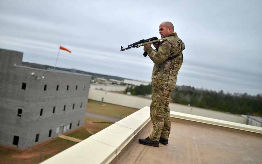 Nathan Cumminskey, an employee of the Guardian Center of Georgia, fires blank rounds at students during a training event at Global Dragon Deployment For Training on on March 13, 2015.
