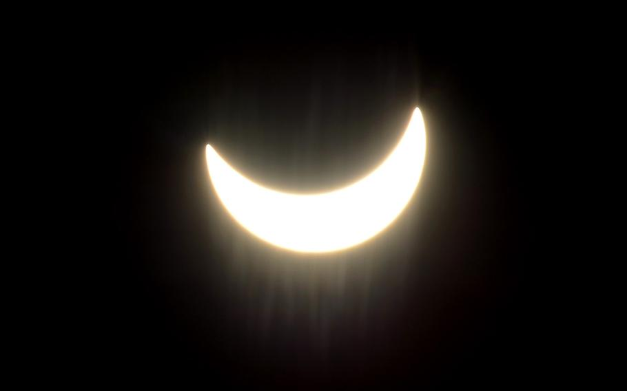 The moon moves across the face of the sun at  10:38 a.m. during a partial solar eclipse over Kaiserslautern, Germany, on the first day of spring, Friday, March 20, 2015.