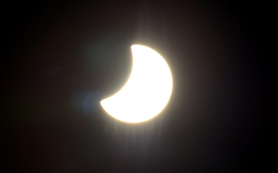 The moon moves across the face of the sun at 11:12 a.m. towards the end of a partial solar eclipse over Kaiserslautern, Germany, on the first day of spring, Friday, March 20, 2015.