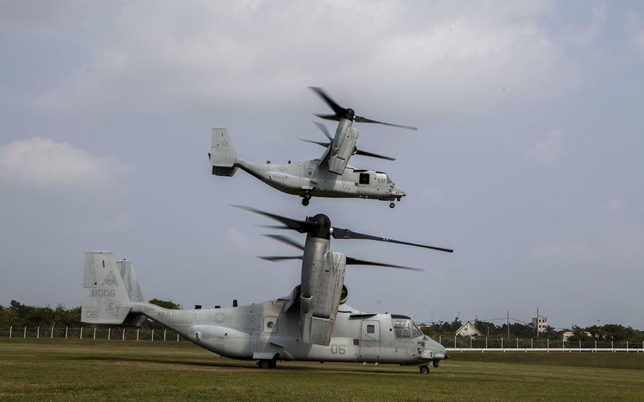 U.S. Marine Corps MV-22 Ospreys with Marine Medium Tiltrotor Squadron 262 (Reinforced), 31st Marine Expeditionary Unit (MEU), take off carrying noncombatant role-players during a Noncombatant Evacuation Operation as part of Certification Exercise, on Camp Hansen, Okinawa, Japan, March 22, 2015.