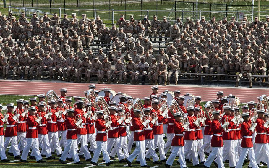 The U.S. Marine Drum and Bugle Corps marches on during a Battle Color Ceremony at Liversedge Field, Camp Lejeune, N.C., on March 24, 2015.