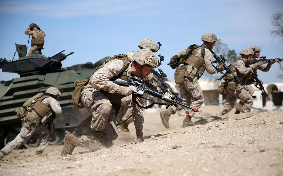 U.S. Marines with the 24th Marine Expeditionary Unit, prepare to assault a simulated objective during Exercise Eagle Resolve 2015 at Failaka Island, Kuwait, March 24, 2015.