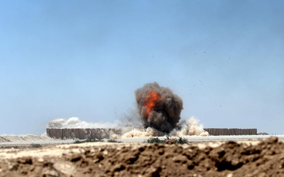 Iraqi army engineers use explosives to blow a hole in concrete blast walls during an exercise at a training range south of Baghdad. The walls are designed to simulate defense used by Islamic State militants around cities like Mosul.