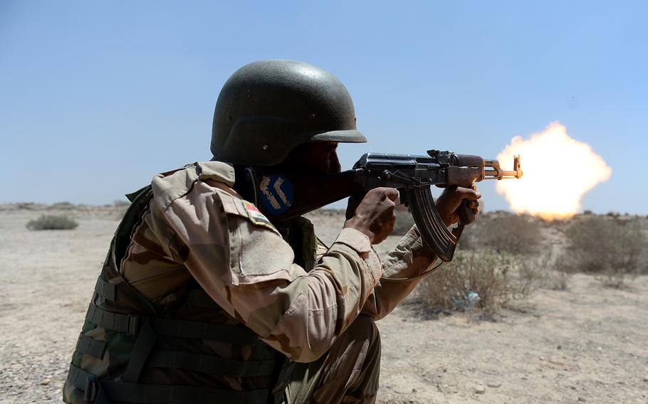 An Iraqi army soldier fires his rifle during a training exercise south of Baghdad designed to build troops? confidence and educate them on threats they may face.