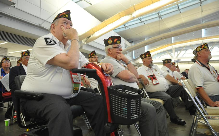 Veterans listen to speeches at the Veterans of Foreign Wars National Convention in Pittsburgh, where President Barack Obama addressed several thousand members on Tuesday, July 21, 2015. Some are worried Obama is trying to cut veterans benefits, while others gave him credit for tackling the VA scandal.