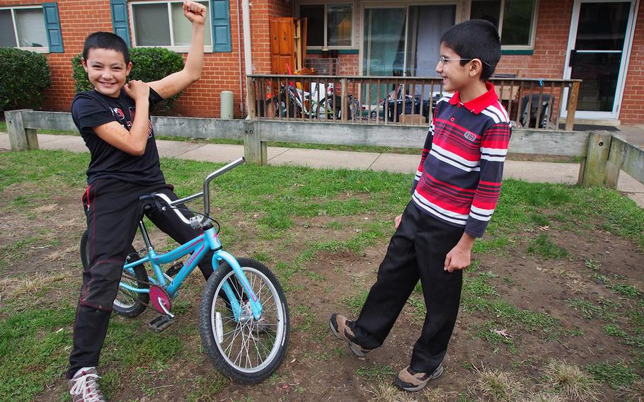 Children of Afghan immigrants who formerly worked as translators for the U.S. military show off for the camera at a Maryland apartment complex where many former interpreters have settled after arriving in the U.S.