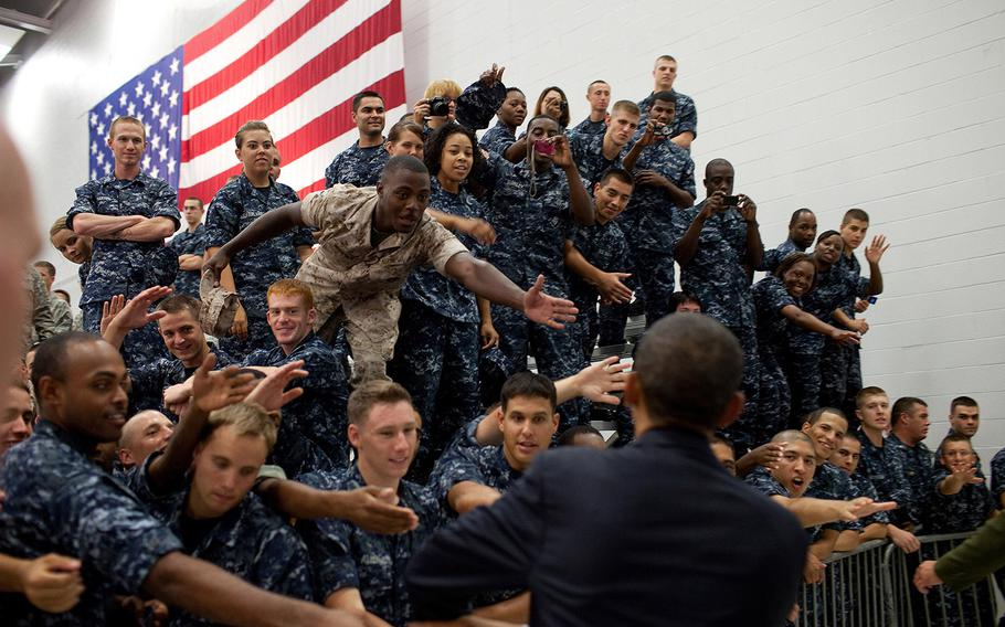 President Barack Obama greets members of the audience following his remarks at an event with military personnel at the Pensacola Naval Air Station in Pensacola, Fla., June 15, 2010. This was the President's fourth trip to the Gulf Coast to assess the ongoing response to the BP oil spill in the Gulf of Mexico.