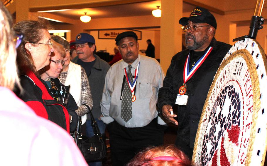 Navy veteran Glenn Towery addresses a group at the 2014 National Veterans Creative Arts Festival in Milwaukee, which was hosted by the Department of Veterans Affairs. Towery won a gold medal at the festival for his painted clock (not shown).