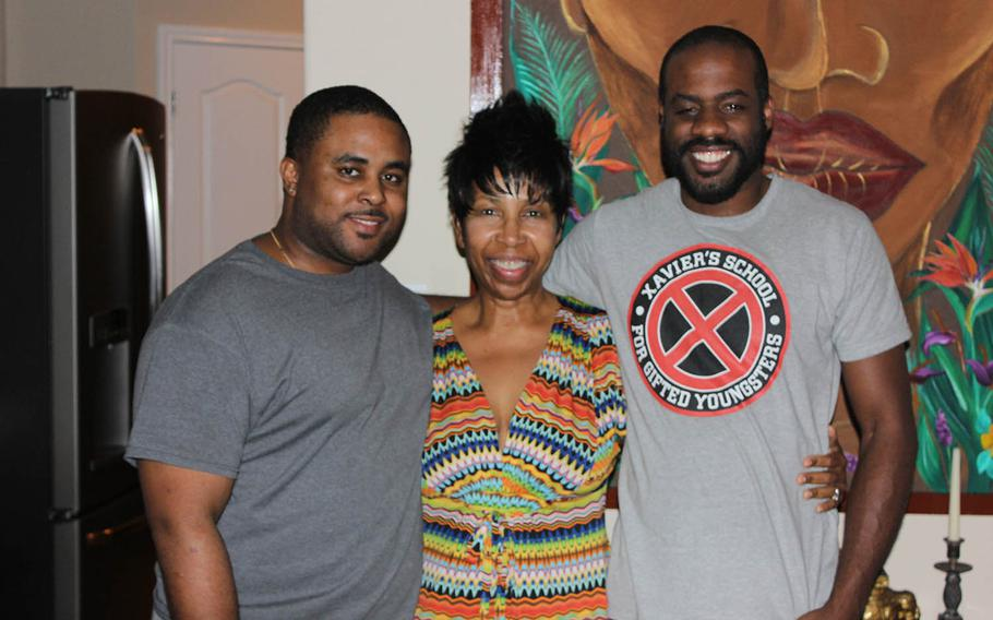 From left, Glenn Towery's stepson, Cole Howard, wife, Juanita Cole-Towery, and son, Keith Towery. Keith Towery is a retired Marine who served as a radioman in Iraq.