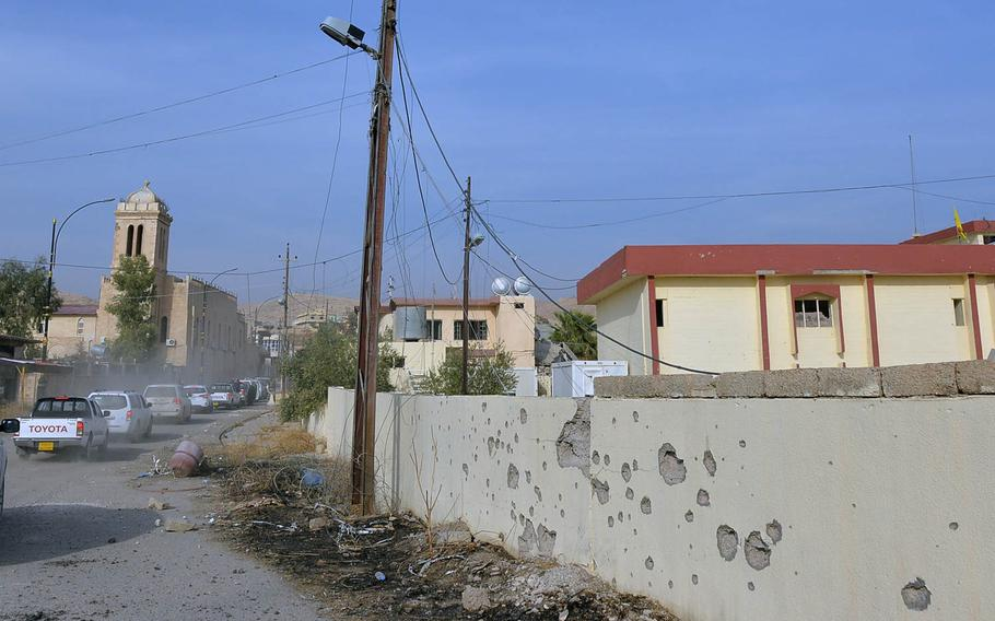A wall not far from St. Shmoni Church in the town of Bashiqa, Iraq, is pocked with bullet holes, shown here on Wednesday, Nov. 9, 2016, shortly after Kurdish peshmerga forces retook the area from Islamic State fighters, who had controlled it for 2 1/2 years.
