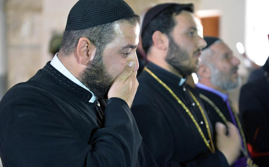 Rev. Safyan Yakub, a priest in the Syrian Orthodox Church, was shocked by the damage he witnessed at St. Shmoni Church in Bashiqa, Iraq, on Wednesday, Nov. 9, 2016. The nave and sanctuary were in disarray and covered in dirt and broken glass in the church where Yakub last said mass in 2014, shortly before fleeing when Islamic State fighters overran the town.