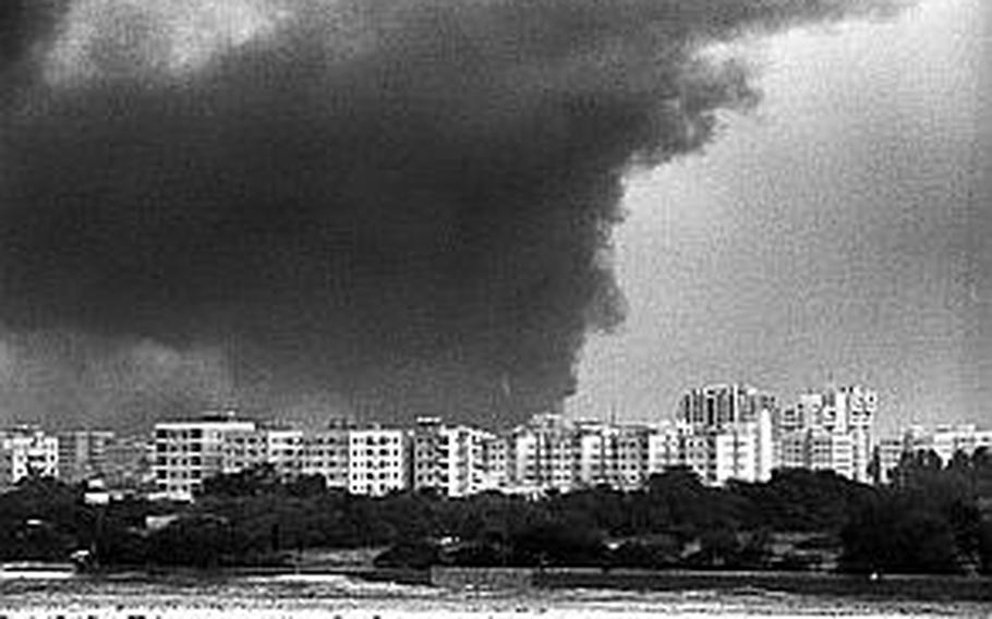 Smoke from oil fires set by Saddam Hussein's troops in Kuwait during Operation Desert Storm in February 1991.