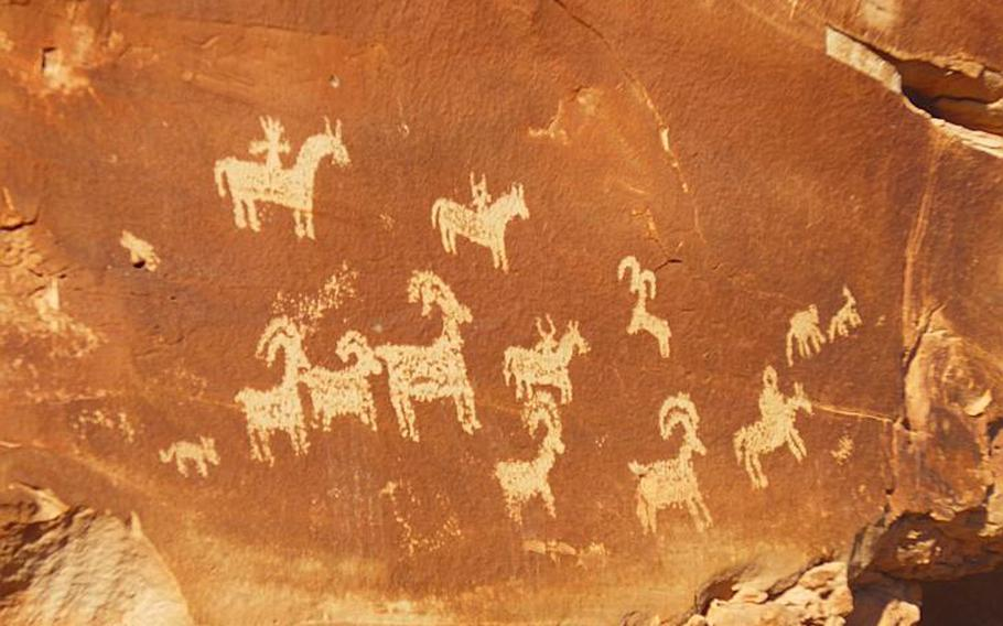 Along the trail to Delicate Arch, visitors can see petroglyphs dating to when the Ute tribe - for which Utah is named - roamed the region. Photo by Elizabeth Zach for The Washington Post