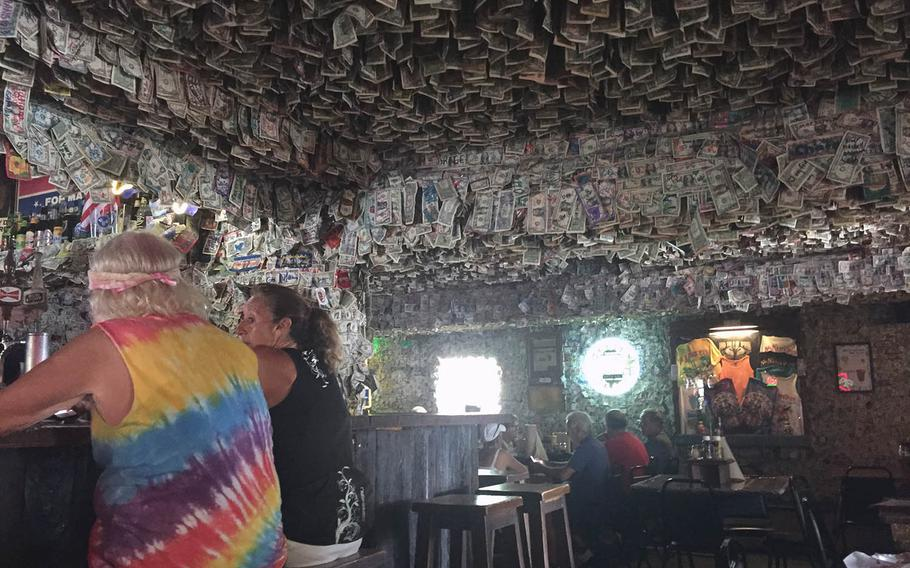 Dollar bills drip from the ceiling and cover the walls at No Name Pub in Big Pine Key, a good place to seek out for pizza, conch fritters and the chance to spot endangered Key deer. (Lori Rackl/Chicago Tribune/TNS)