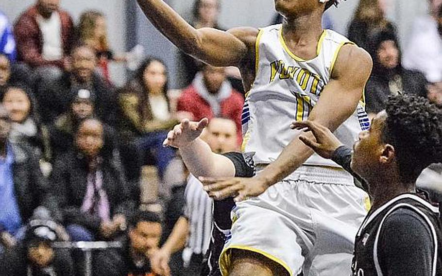 Yokota's Kishaun Kimble-Brooks drives for a layup against Zama during Friday's boys basketball game, won by the Panthers 84-49.