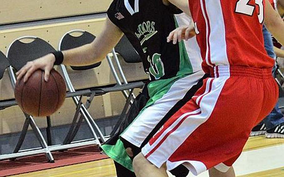 Daegu's Jacob Litton dribbles against Seoul Foreign's Nick Larsen during Friday's boys basketball game. The Crusaders won 80-26.