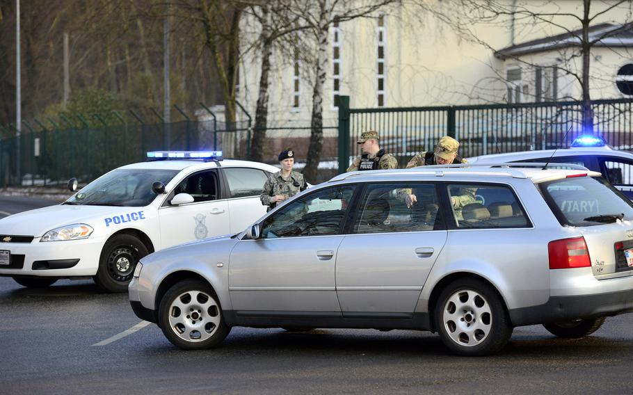 U.S. Army Military Police and Air Force Security Forces direct traffic away from the gate at Pulaski Barracks in Kaiserslautern, Germany, on Monday, Jan. 23, 2017. The gate was closed for several hours due to a unspecified security incident.