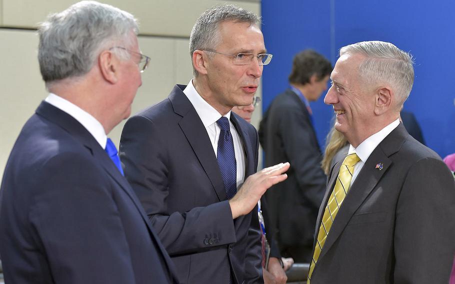 British Defense Minister Michael Fallon, left, talks with NATO Secretary-General Jens Stoltenberg and U.S. Defense Secretary Jim Mattis at NATO headquarters in Brussels on Thursday, Feb. 16, 2017.