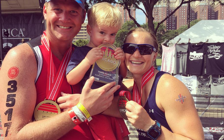 Melissa Stockwell with husband Brian and son Dallas after the Chicago triathlon in Aug. 2015.