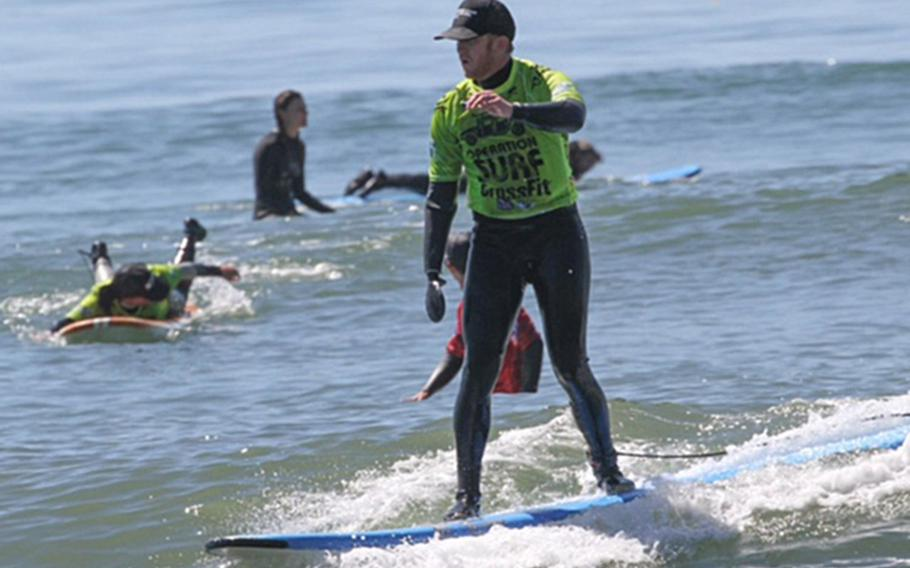 Since Marine James Sides lost a hand in a bomb blast in Afghanistan in 2012, he has devoted his time to becoming an expert in surfing and snowboarding. Here Sides participates in a March 2016 surf camp in Santa Cruz, Calif.