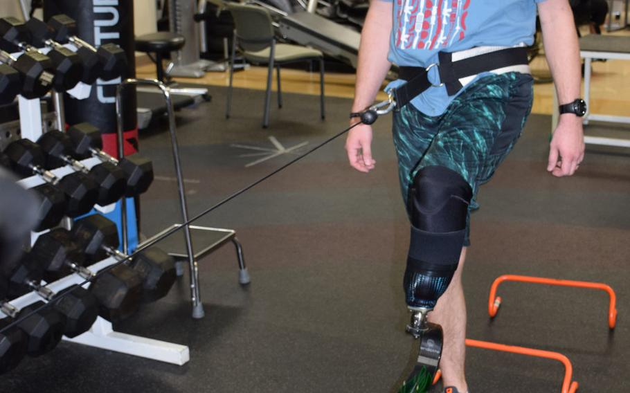 Aubrey Hand, a medically retired senior airman, works out with his prosthesis Feb.10 at the Military Advanced Training Center for amputees at the Walter Reed National Military Medical Center. Hand's left foot was amputated in June, four years after he was injured in a bomb explosion in Afghanistan.