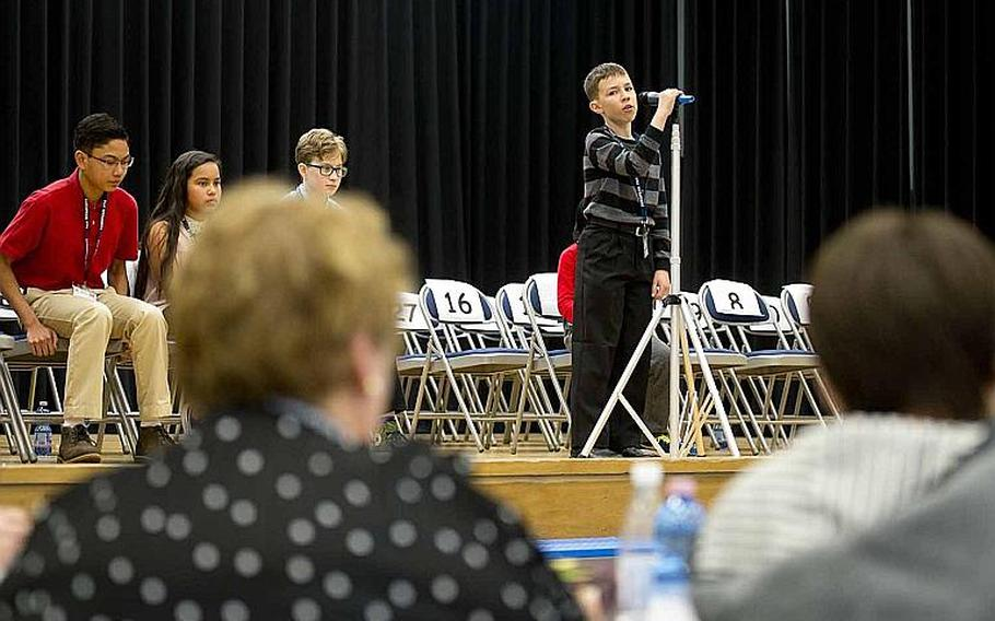 Robert Rasmussen, from Gafenwoehr Elementary School, spells a word for judges during the 35th annual European PTA Spelling Bee at Ramstein Air Base, Germany, on Saturday, March 18, 2017.