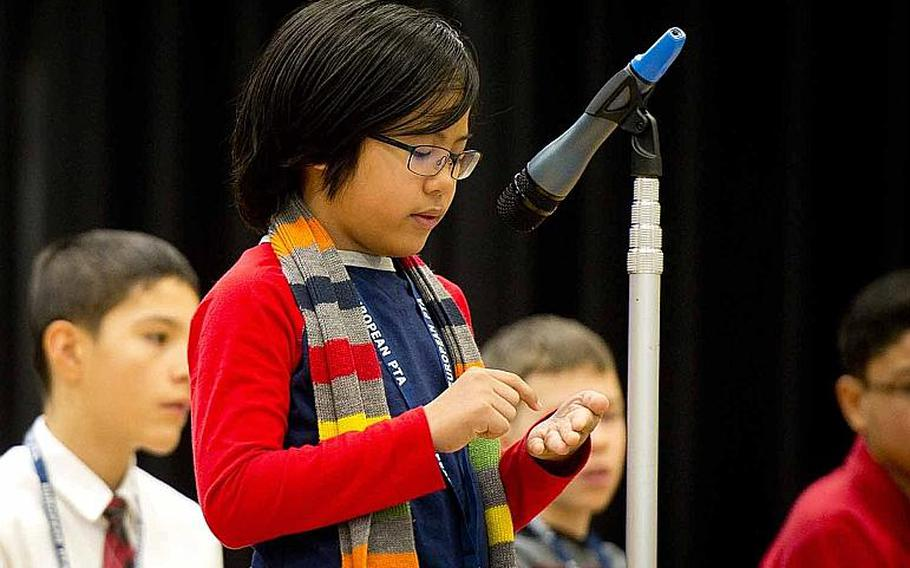 Ramstein Middle School's Ramon Padua Jr. spells a word on his hand during the 35th annual European PTA Spelling Bee at Ramstein Air Base, Germany, on Saturday, March 18, 2017.