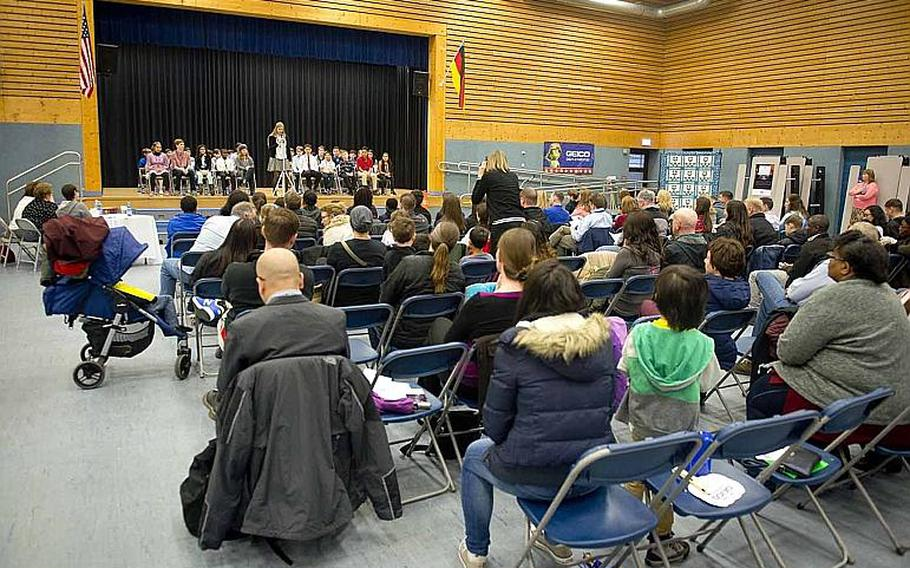 Spectators listen to elementary and middle school students introduce themselves during the 35th annual European PTA Spelling Bee at Ramstein Air Base, Germany, on Saturday, March 18, 2017.