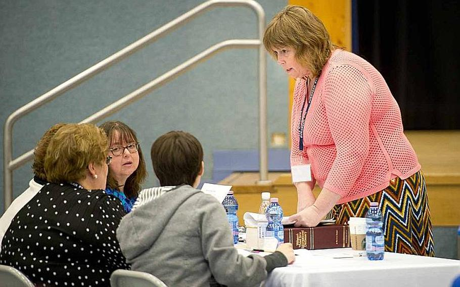 Moderator Sharon Emerling, right, a teacher at Landstuhl Elementary/Middle School, discusses the pronunciation of a word during the 35th annual European PTA Spelling Bee at Ramstein Air Base, Germany, on Saturday, March 18, 2017. Elementary and middle school students from 31 different schools competed in the bee.