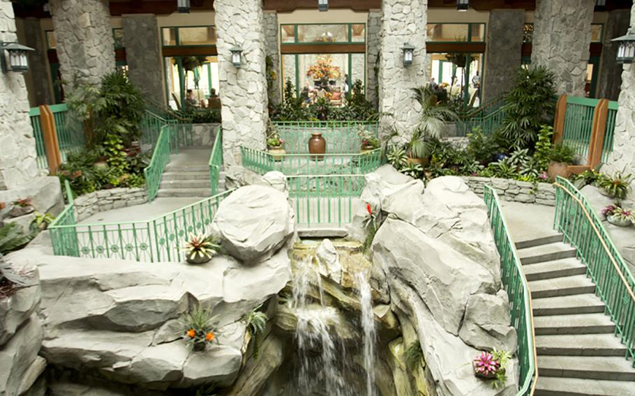 The main staircase at Shades of Green encircles a two-story-tall rock outcrop with waterfalls plunging through it. Shades of Green is a U.S. Department of Defense-owned resort in Lake Buena Vista, Fla., near Orlando, at Walt Disney World.