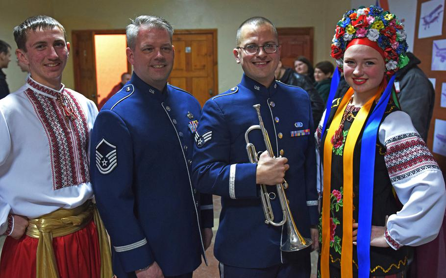 Master Sgt. Dave Dell stands with two residents of Kropyvnytskyi, Ukraine, after the U.S. Air Forces in Europe jazz band performance, March 25, 2017. The band's tour of Ukraine ends April 2.