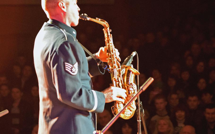 Staff Sgt. Brian Connelly plays a saxophone solo during a performance at the Kropyvnytskyi Aviation Academy in Kropyvnytskyi, Ukraine, March 25, 2017. U.S. Air Forces in Europe's jazz band played for nearly 600 people at the civilian flight school.