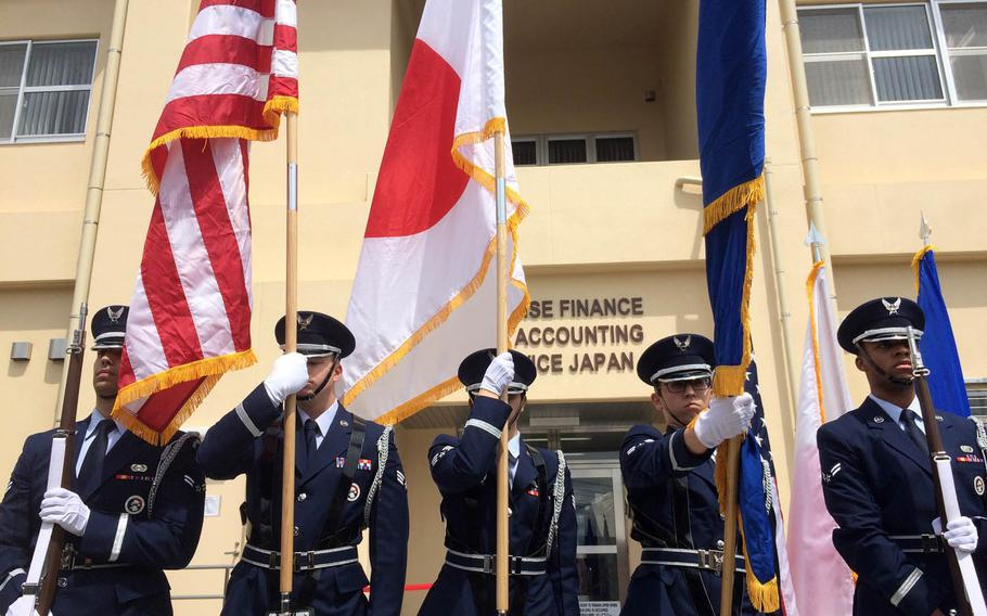 Members of the Yokota Air Base Honor Guard participate in a ceremony for the opening of a new Defense Finance and Accounting Service facility at Yokota Air Base, Japan, Wednesday, May 3, 2017.