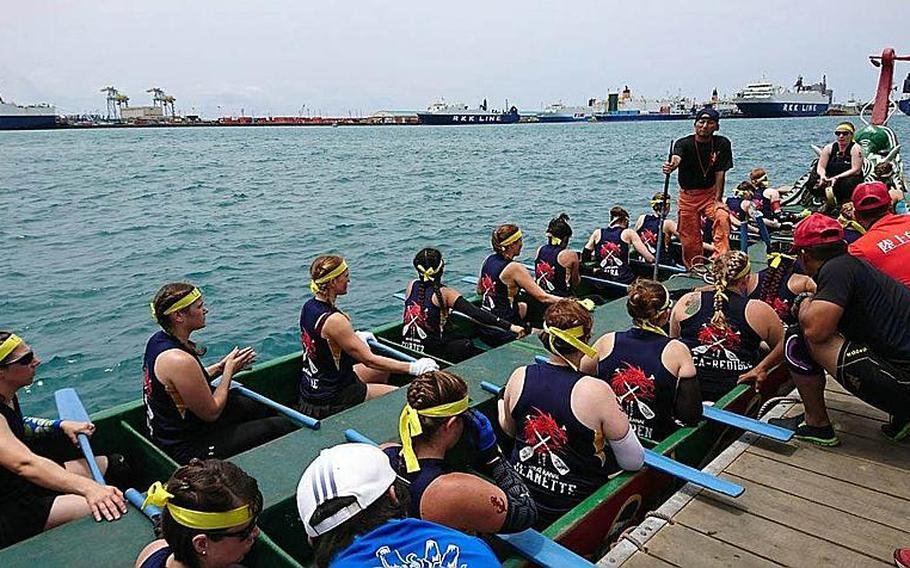 Nirai Kanai, the U.S. Navy Women's Dragon Boat Team, prepares for the race in Naha, Okinawa, Friday, May 5, 2017.