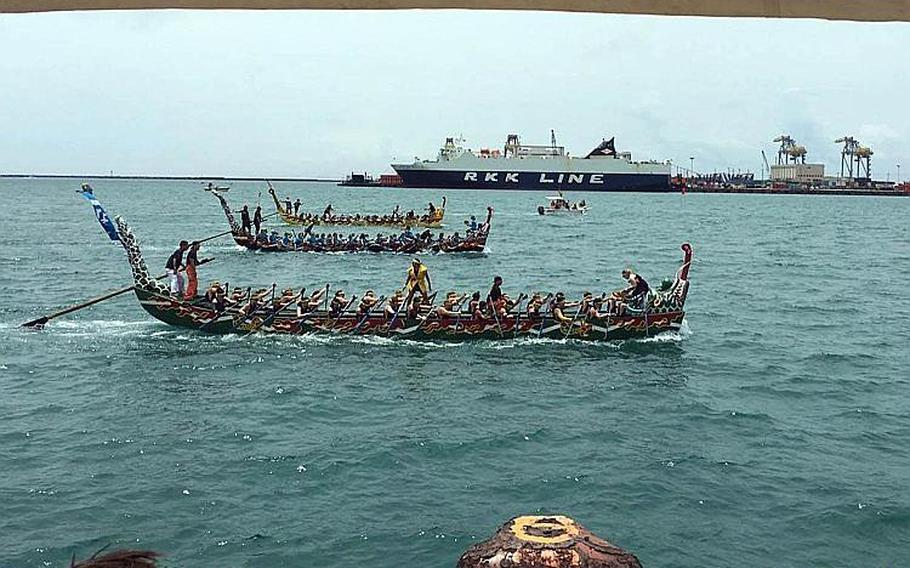 Nirai Kanai, the U.S. Navy Women's Dragon Boat Team, foreground, races in Naha, Okinawa, Friday, May 5, 2017.