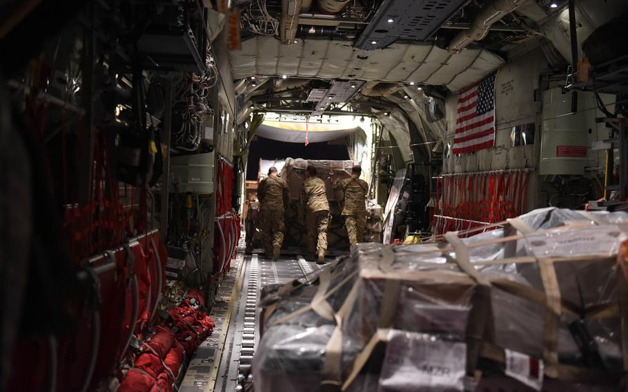 A C-130J crew from the 774th Expeditionary Airlift Squadron offloads cargo at Mazar-e-Sharif, Afghanistan, May 4, 2017.