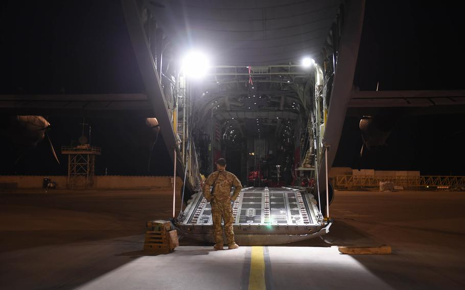 Capt. Brennan Wolford, 29, of Thornville, Ohio, waits for cargo to be loaded onto a C-130J from the 774th Expeditionary Airlift Squadron at Mazar-e-Sharif, Afghanistan, May 4, 2017.