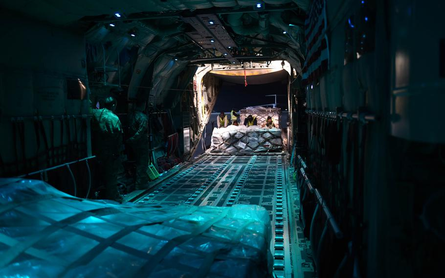 Ground crews load a pallet onto a C-130J from the 774th Expeditionary Airlift Squadron, at Kandahar Air Field, Afghanistan, May 4, 2017.