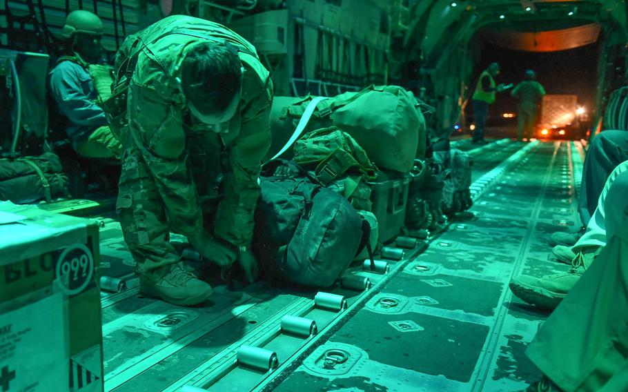 Capt. Brennan Wolford, 29, of Thornville, Ohio, lashes down baggage on a C-130J from the 774th Expeditionary Airlift Squadron at Camp Dwyer, Afghanistan, May 5, 2017.